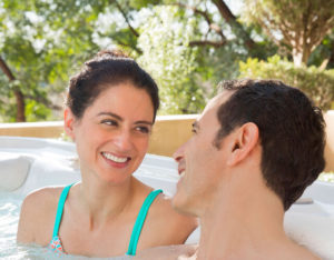 Hot Spring Spas Oregon Couple Smiling in Hot Tub